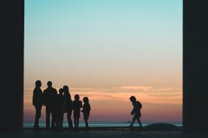 Silhouette of family standing on beach during sunset